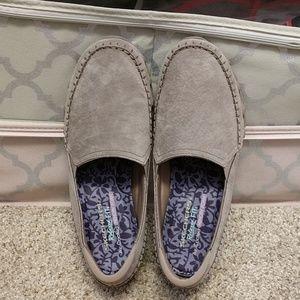 Pair of grey Skechers shoes.